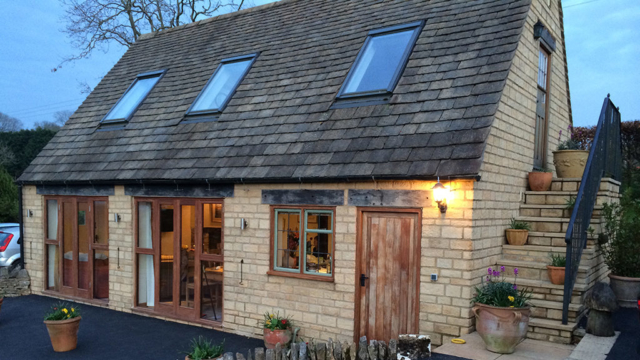 Sheepscombe Byre holiday cottage in the gloaming