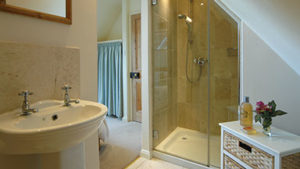 Sheepscombe Byre holiday cottage: The Blue Room's sparkly clean shower room